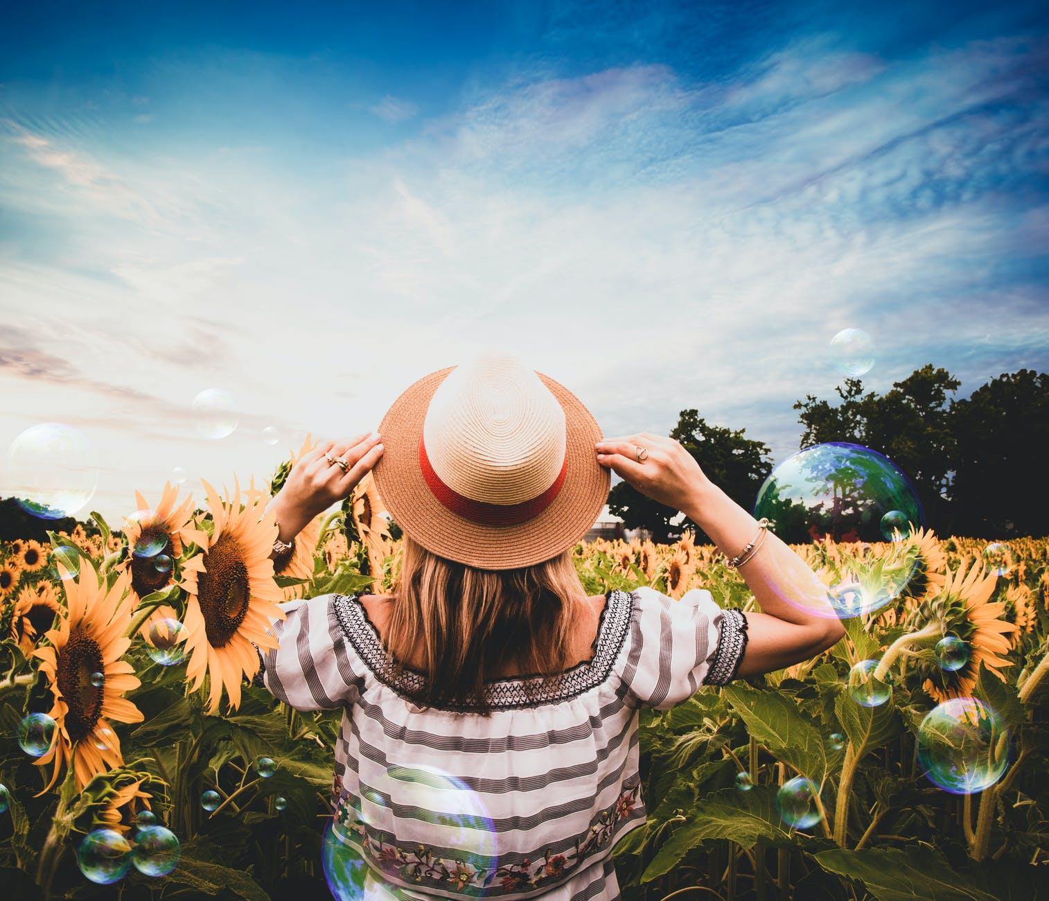 GIRL SUN RED HAT