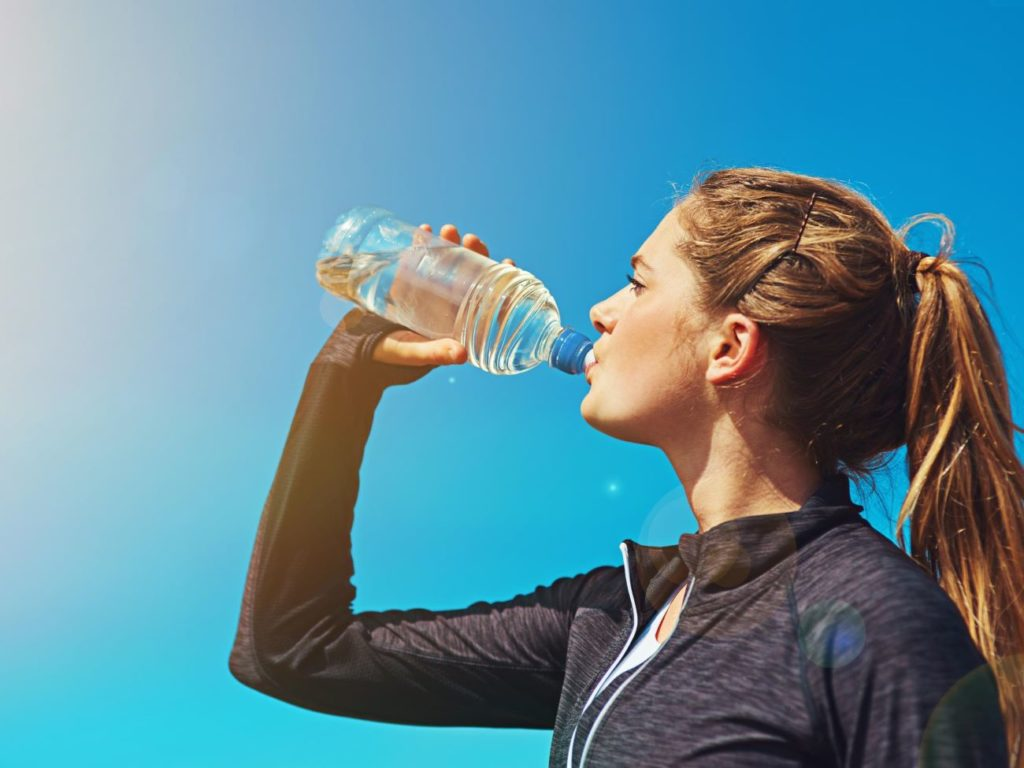 GIRL DRINKS WATER