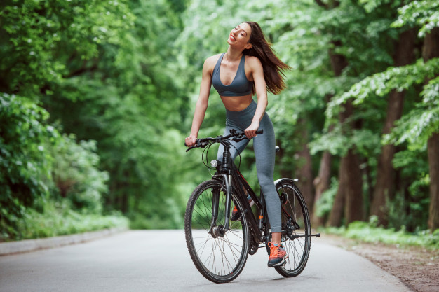 WOMAN BICYCLE