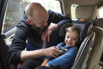 DAD AND CHILD AT THE CAR